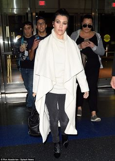 Adored: Kourtney Kardashian was followed by fans as she arrived to JFK airport in NY on Tuesday