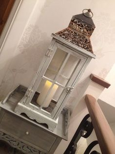 Lovely shabby lantern and stand on landing