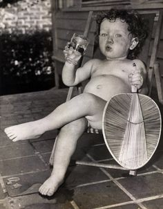 When the July sun got too hot for 18 month old Judy Ham, she retreated to the shade of the porch, stripped her clothing, grabbed a fan, and defied the heat with a cool drink. S)
