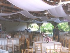 We provided billowing satin to enhance the rustic rafters for Brittany & Carl in Audubon.
