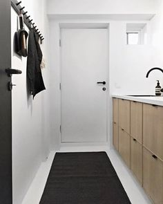Our laundryroom AFTER swipe to the right to see how it looked BEFORE vaskerom renovering renovations nordiskehjem tvttstuga skandinaviskehjem Ikea Sofa, Hanging Canvas, Home Reno, Scandinavian Interior, Mudroom, Decoration, Cover Design, Laundry Room, Home Goods
