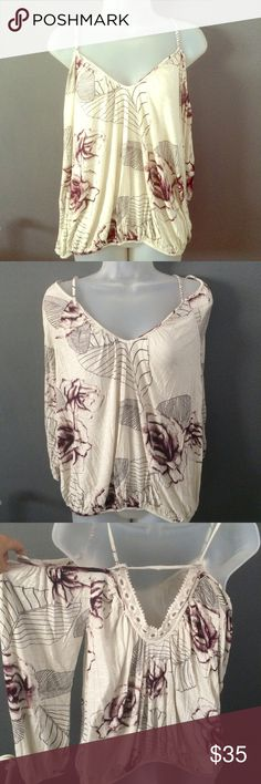 Sold in bundle💕Free People top Gorgeous Free People long sleeve top with open shoulders. Rose floral pattern in ivory and  shades of purple. Size medium. Thin comfortable material makes this top versatile enough to wear in any season. No trades 🅿️🅿️ or Ⓜ️ercari. Ask me about bundles 💕 offers always considered when submitted via the offer button 💋 Free People Tops Blouses