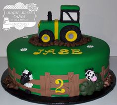 "2 layer, 12"" cake iced in fondant w/hand made fondant decorations. The tractor was made out of rice crispy treats then covered in fondant. TFL!"