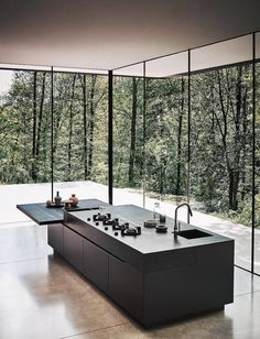 Minimal black kitchen island bench surrounded by tall windows with natural light. - Minimal black kitchen island bench surrounded by tall windows with natural light Modern home House design Source by - Modern Kitchen Design, Modern House Design, Interior Design Kitchen, Kitchen Decor, Room Interior, Kitchen Designs, Kitchen Ideas, Diy Kitchen, Glass Kitchen