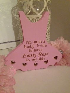 A beautiful chunky wooden freestanding dress decorated with pretty cut out hearts. Personalised with the wording of your choice, this gorgeous sign would make a special keepsake gift for your special Bridesmaid or Flower Girl. The sign can also be personalised with your special dates on the reverse. AVAILABLE IN PINK & WHITE http://abeautifulsign.com/product/im-such-a-lucky-bride-dress/