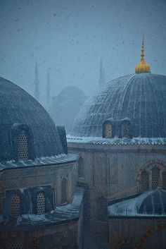 The Aya Sophia with the Blue Mosque in the background on a snowy morning. Location: Istanbul,Turkey