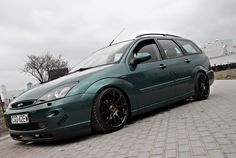 Green Ford Focus MK1 - Celis Hella headlamps, big amazing rims - Tomason TN1