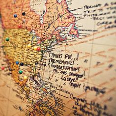 In lieu of traditional guest book, the couple displayed a map; guests used pushpins to mark the location from which they'd traveled, and wrote well wishes. Maria Vicencio Photography.