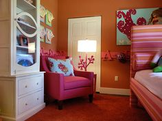 Bold and beautiful, with bright orange walls, hot-pink furnishings and off-white detailing.