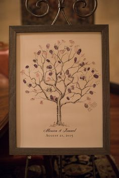 A thumbprint tree is a unique way for guests to sign in! | Pixeldust Photography | villasiena.cc