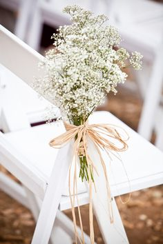 Subtle, yet chic,Baby's breath flowers for ceremony chair aisle. #TOMSwedding