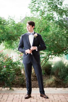 Navy suit and bow tie.  Photo by: Lindsey Mueller Photography