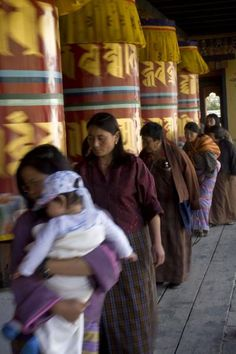 Bhutanese keeping the prayer wheels in motion (National Memorial Chorten, Thimphu, Bhutan)