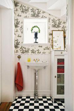Checker Board floor. Small bathroom. Wallpaper. Wainscoting. Interesting pedestal sink. #bathroom #black and white