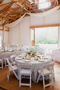 Wedding Barn Reception Layout, round tables, white and blue gray linens, simple reception, wood and white barn, wedding celebration