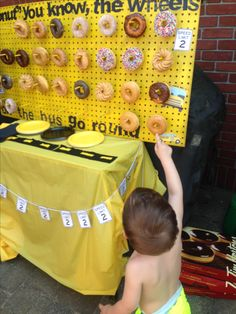Wheels on the bus-themed 2nd birthday party Donut wall