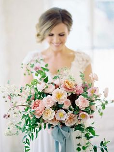 Peach and Blush Bouquet with a Bold Blue Ribbon | Ryan Ray Photography | http://heyweddinglady.com/20-bouquets-spring-garden-wedding/