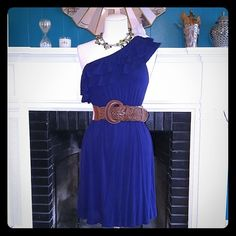 One strap navy blue dress I know in the first picture it looks royal blue but it is in fact navy blue. It has one shoulder with 2 ruffles all around, it is very stretchable so anywhere from xsmall to a medium. Accessories used not for sale Dresses One Shoulder