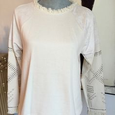 Zara Ivory Studded Sweatshirt Size Medium Straight cut sweatshirt. Frayed round neck and frayed long sleeve on the wrist. Silver stud On the arms. Faux suede on the upper arms. Length is 22 inches from collar to hem. Width is 38 inches. 86% cotton. 14% polyamide. Zara Tops Sweatshirts & Hoodies
