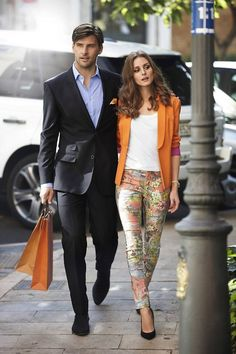 Orange blazer, floral pants...Olivia is always on top of it!