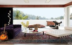 I love Adam Levine's house. Jean Prouvé cocktail table, Hans J. Wegner Ox chair, and a Ludwig Mies van der Rohe daybed.      (architecturaldigest.com)