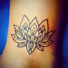 Lotus flower girl tattoo ankle