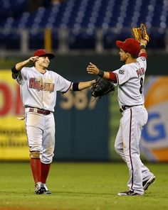 Tony Campana and Gerardo Parra go for a hug after winning a marathon 18-inning game on August 24, 2013