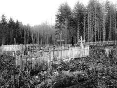 Surrounded by a weathered picket fence, this is the grave of Mary Kitsap at St. Peter's Catholic cemetery in Suquamish, photographed in 1911