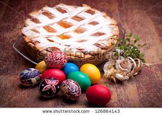 Sold! Stock photo available for sale at Shutterstock: PASTIERA and colorful Easter eggs. Pastiera is a traditional Italian Easter pie made with wheat and ricotta cheese; at Naples is also known as Pizza Gran. - stock photo