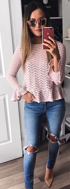 #spring #outfits woman in pink long-sleeved shirt and distressed blue denim jeans taking selfie. Pic by @my.style.experiment