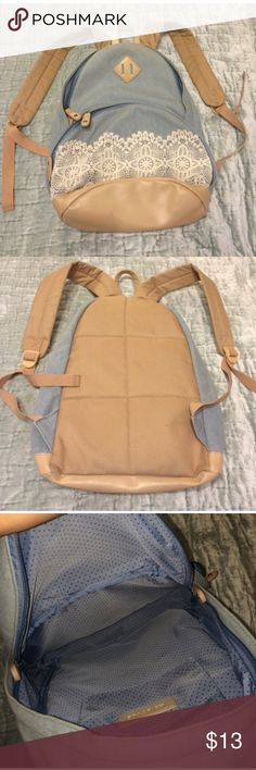 Baby blue small backpack Great color! Used lightly. Some minor stains that are shown in picture & some very minor ware on interior of pack, but the listed price makes up for these imperfections by a long shot. Other