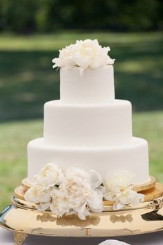 Simple White Cake Atop a Gold Stand   French Inspired New England Wedding