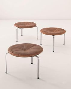 Poul Kjærholm | Three rare and large PK 33 stools, 1960s | Chrome-plated bent steel, original leather, painted moulded laminated plywood seat support, rubber | Mfd. by E. Kold Christensen, Denmark