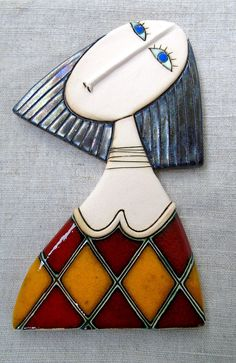 Ceramic art tile Girl with Red Dress Size 17,5/10sm.=7/4 inches Every tile is made one at a time using wet clay, trimmed, dried, fired, glazed and fired a second time. It will easily hang on a nail in the wall. These girls are individual statement pieces of art or