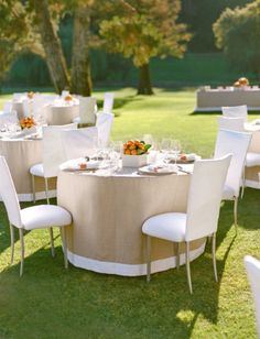 neutral fitted round linen with pretty trim by @Lisa Vorce. Photography by Aaron Delesie via @Style Me Pretty #wedding #summerwedding