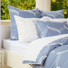 The cascading ribbon pattern  on this duvet set contrasts beautifully against a sophisticated blue palette. Great site for designer bedding and priced right!