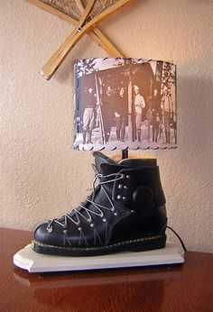 This lamp is made exclusively for Vintage Snow from genuine antique lace-up leather ski boots. 18' tall, 10' oval shade. Made in USA.
