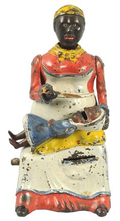 June 22nd Auction. Cast Iron Mammy with Spoon Mechanical Bank. Manufactured by Kyser & Rex. #Banks #MorphyAuctions