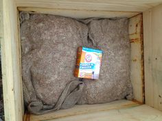 Burlap Bag of Cedar Shavings and Box of Baking Soda in hive top for overwinter insulation and wax moth repellant