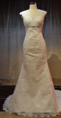 Cap sleeve wedding dresses made with beaded lace.  We have other wedding gowns with covered shoulders on our website.