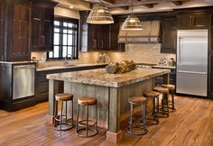 knotty alder cabinets; kitchen cabinetry; island; inset doors; metal accents; glazed; stained; distresedl rustic; custom