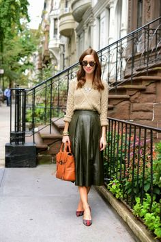 Tan knit, olive green leather midi skirt, plaid heels, and rust tote