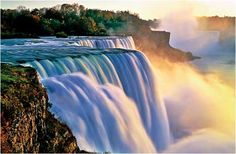 Niagara Falls:  Comprised of 2 sections separated by Goat Island: Horseshoe Falls on the Canadian side & Bridal Veil Falls on the American side.Horseshoe Falls is 2,600' wide.American Falls is1,060' wide.The highest drop is173' on Horseshoe Falls.Niagara Falls was formed when glaciers receded at the end of the Wisconsin glaciation(the last ice age) & water from the Great Lakes carved a path thru the Niagara Escarpment en route to the Atlantic Ocean.It is the most powerful waterfall in N…