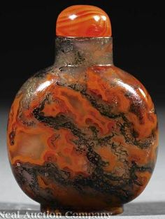 Chinese moss agate snuff bottle, 19th century, translucent stone with red and ochre jasper veins and green dendritic inclusions, with stopper
