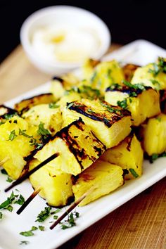 Grilled pineapple kabobs with honey yogurt sauce. Yum.