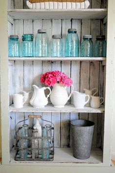 old blue jars, milkglass, and vintage bottles, distressed wood...everything I love! one day, one day...