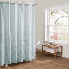 Add warmth and interest to your bathroom decor with Esme shower curtain. Intertwined arches with ruffle detail add texture and character to the fabric surface. The soft blue tone is sure to accent your decor.