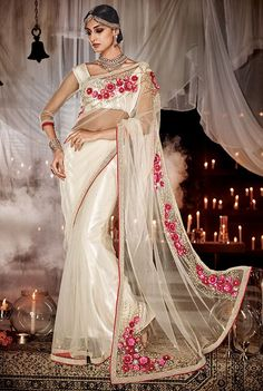 Cream net designer saree, perfect piece for wedding functions. A stunning saree with intricate detailing on the back, heavy moti work and dana work. ‪#‎DrezzlingSarees‬