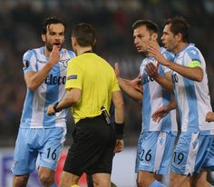 Marco Parolo with his teammates of SS Lazio reacts against the referee Ovidiu Hategan during the UEFA Europa League quarter final leg one match between SS Lazio and RB Salzburg at Stadio Olimpico on April 5, 2018 in Rome, Italy. - 60 of 120