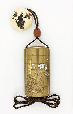 Kajikawa School (Japan, died N/A)   Inro; Ojime Netsuke, late 18th-early 19th century  Costume/clothing accessory/waistwear, Five-case inro; design of plum and shrub on gold and red-gold ground, fundame ground inlaid with mother-of-pearl and coral, amber ojime, takamakie on two-piece ivory manju with colored lacquer by Shibayama